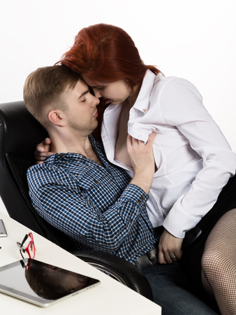 young sexy secretary is sexually harassing to her boss. love affair at work Stock fotó