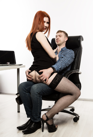 young sexy secretary is sexually harassing to her boss. love affair at work Stock Photo