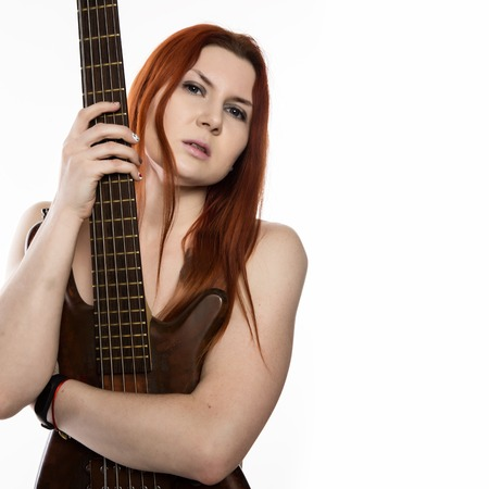 sexy nude rock woman playing on electric guitar on a white background. free space for text