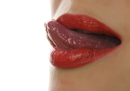 Extreme close up of sexy lip. Woman pursing her lips in a sexy seductive gesture.