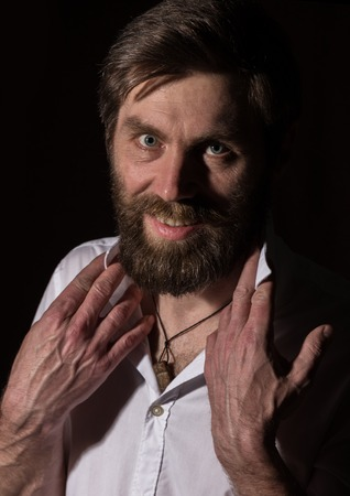 Portrait handsome bearded man, sexy guy on a dark background Standard-Bild - 124450427