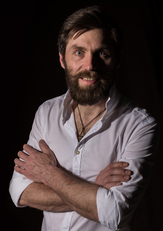 Portrait handsome bearded man, sexy guy on a dark background Standard-Bild - 124450434