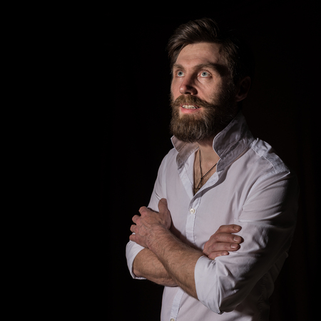 Portrait handsome bearded man, sexy guy on a dark background Standard-Bild - 124450435
