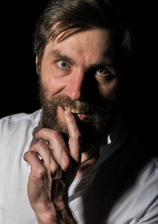 Portrait handsome bearded man, sexy guy on a dark background Standard-Bild - 124446861