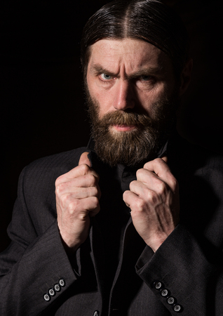 vintage handsome bearded man. severe man on a dark background. free space for your text Standard-Bild - 124446866