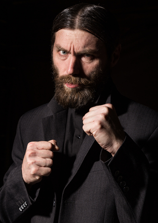 vintage handsome bearded man. severe man on a dark background. free space for your text Standard-Bild - 124446875