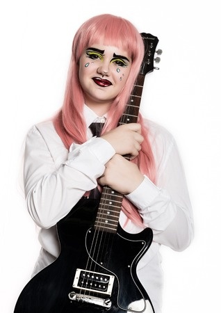 young girl with professional comic pop art make-up holding electric guitar. Funny cartoon or comic strip make-up Standard-Bild - 124447316