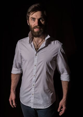 Portrait handsome bearded man, sexy guy on a dark background Stock Photo