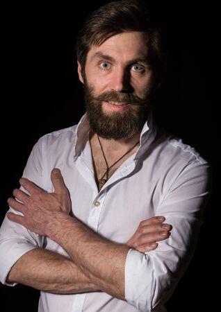 Portrait handsome bearded man, sexy guy on a dark background Stock fotó