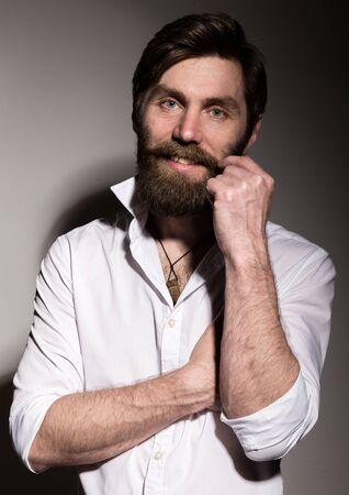 Portrait handsome bearded man, sexy guy on a dark background Reklamní fotografie