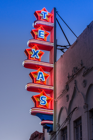 Neon sign in the shape of stars that spell Texas