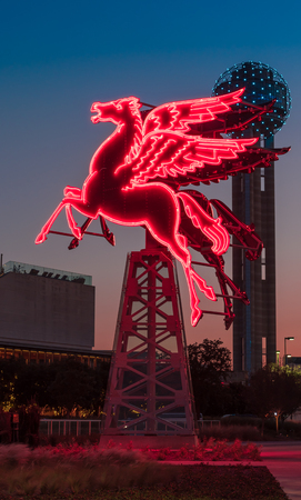 Pegasus neon sign lit up at sunset in Dallas Texas.