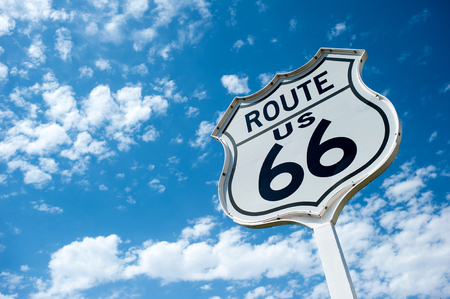 Route 66 angaist blue sky with white puffy clouds