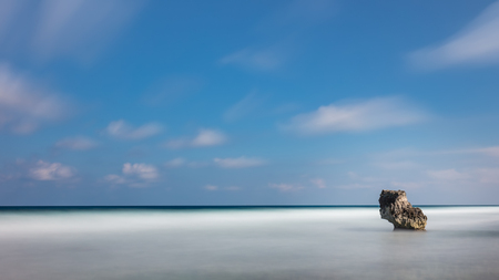 Long Exposure Sea Stack with Puffy Clouds
