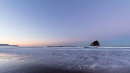 Morning at Haystack Rock in Pacific City, Oregon Reklamní fotografie