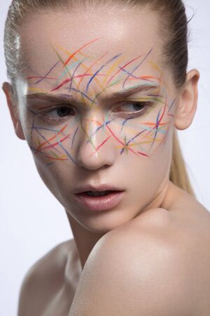 cian: woman with perfect skin and colored lines red orange blue cian yellow