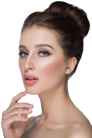 beige lips: Perfect woman face portrait lips with fashion natural beige matte lipstick makeup. Beauty brunette sexy model girl with beautiful skin close her eyes and touching her lips. Stock Photo