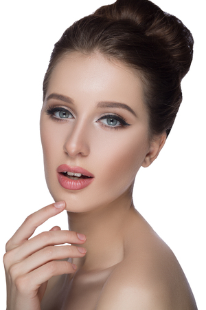 Perfect woman face portrait lips with fashion natural beige matte lipstick makeup. Beauty brunette sexy model girl with beautiful skin close her eyes and touching her lips. Stock Photo