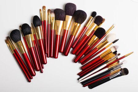 flat brushes: Flat lay. Makeup brushes on white background