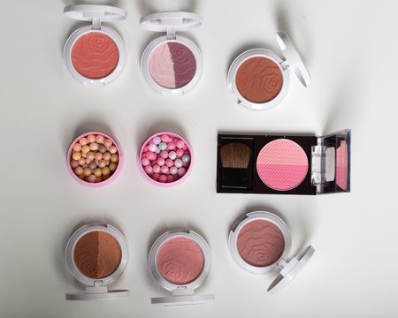 A huge set of beauty cosmetics or make-up laid flat and askewed.