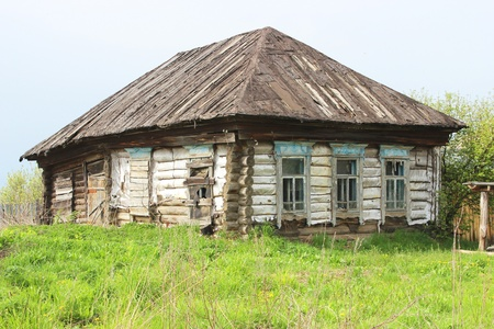 Abandoned wooden house with boarded up windows in the Russian countryside. photo