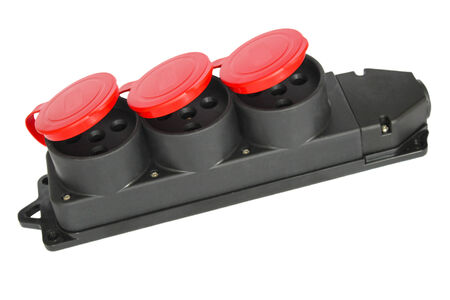 isolator insulator: Electrical three-phase sockets in a plastic casing and red caps to protect from moisture Stock Photo