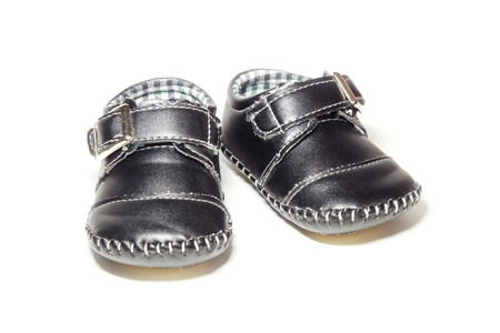 children's wear: Baby dark blue leather booties isolated on white