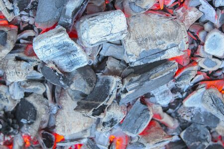 slag: The dying embers in the fire close-up as background