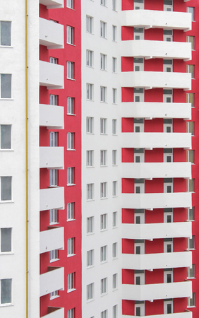 built: The new built high-rise white-red apartment building