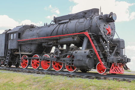 Old Soviet locomotive standing on the siding Stock Photo