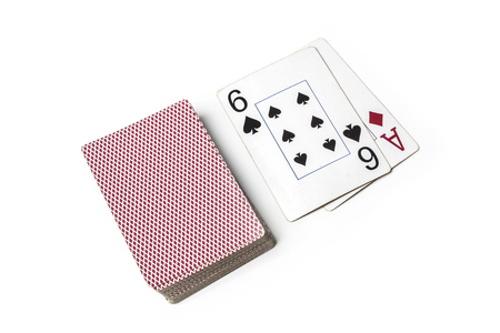 A deck of cards isolated on white. Sixes beats an ace Stock Photo