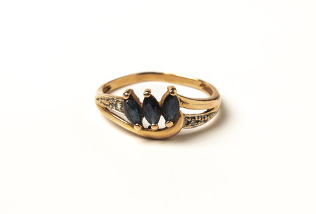 Female gold ring, adorned with sapphires sapphires isolated on white