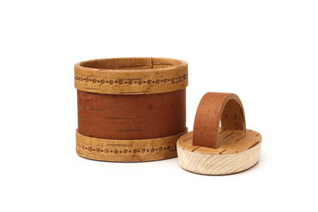 Basket from a birch bark with a wooden lid isolated on a white background