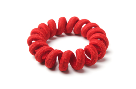 Bracelet made of red rubber, twisted into a spiral Reklamní fotografie