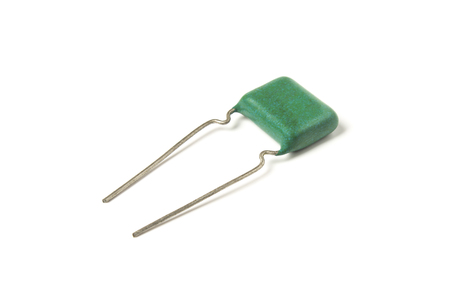 Electric capacitor close-up isolated on white