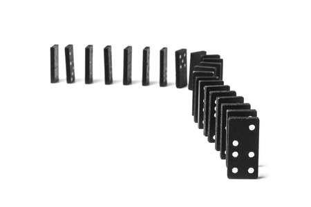 Domino chips are set in a chain for each other Foto de archivo