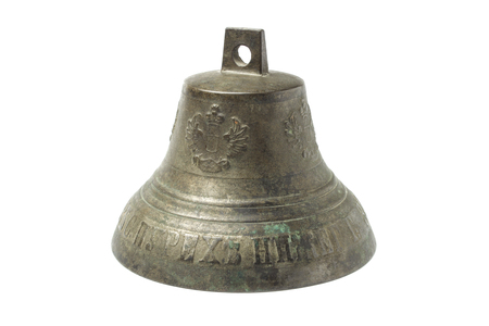 An old bronze bell for a horse carriage with the image of a coat of arms with a two-headed eagle
