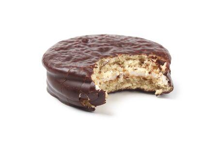 Bitten chocolate cake on white background