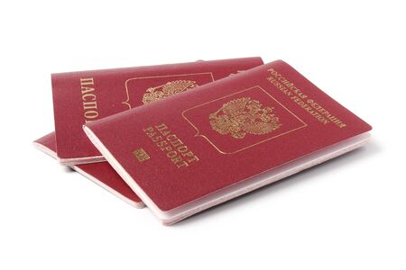 Several Russian foreign passports isolated on white background Foto de archivo
