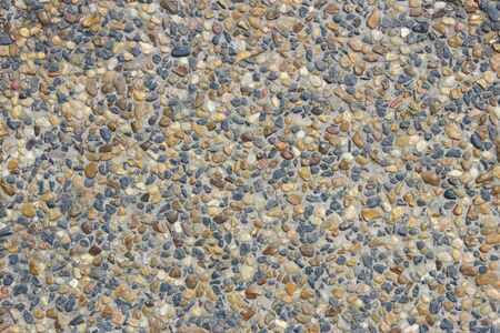 Stone surface covered with small pebbles as background Banque d'images