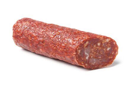 Chorizo slice close up isolated on white