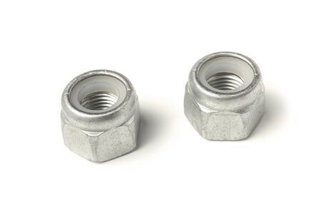 Self-locking nuts closeup isolated on white background