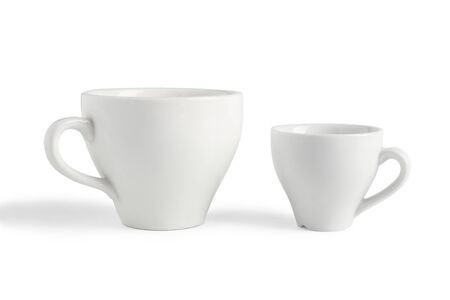 Two white porcelain coffee cups isolated on white background Фото со стока