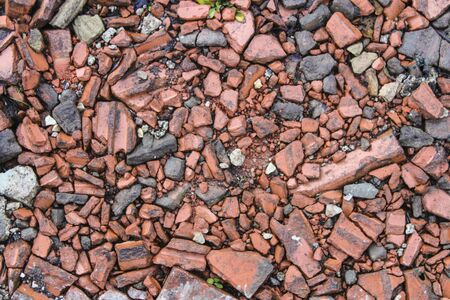 Broken brick road surface as a background close-up