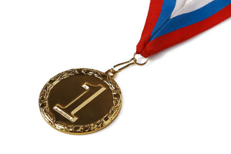 Gold medal for first place in competition isolated on white background Stock Photo