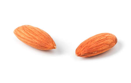 Peeled almond kernels close up isolated on white background