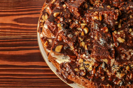 Handmade sponge cake with nuts and cocoa close-up