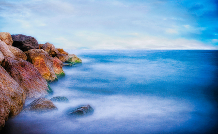 dam rocks and a silky sea for a long exposure of photography. The place is in El Prat de Llobregat in Barcelona. 写真素材