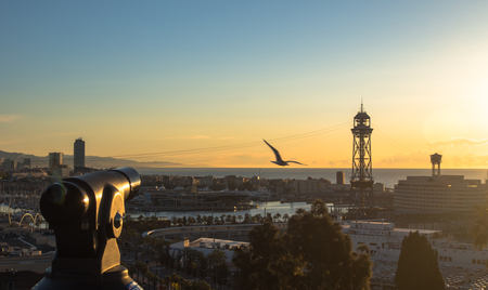 image of the city of barcelona and its cable car from the oriel of Miramar in montjuic. photography at sunrise. Imagens