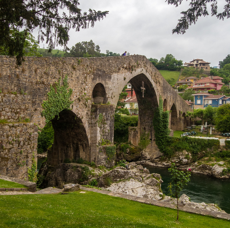 Roman bridge in Cangas de Onis. A very tourist place at the foot of the Picos de Europa. Stock Photo